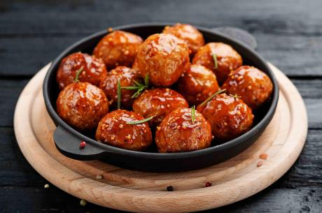 Moink balls with barbecue sauce